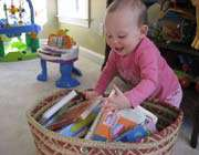 baby in book bag