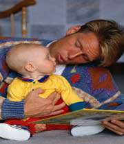 father  reading book for his child