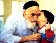 a child kissing imam khomeini