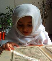 girl reading quran