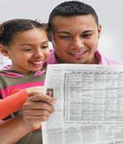 father and kid reading news