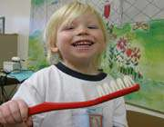 a kid with toothbrush