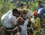 filipino aid workers rush to help the victims of the fatal bus cash, most of whom were iranian.