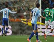 mexico goalkeeper oscar perez (back, r) concedes a goal by argentina striker carlos tevez (unseen) in johannesburg.