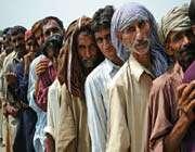 flood victims queue for aid in sanawan, punjab province, pakistan.