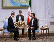 le président ahmadinejad et kinichi komano