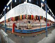some 300 iranian carpet weavers are working on what will be the worlds next largest carpet.