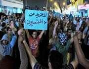 saudi protesters chant slogans during a protest in al-qatif, saudi arabia