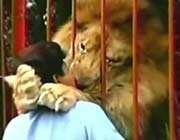 lion hugging woman