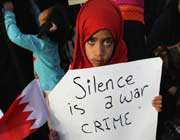 this file photo shows a youngster holding up a placard during an anti-government protest in bahrain's capital, manama.