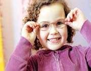 kid wearing glasses