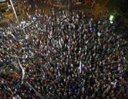 israelis march on a main road in tel aviv during a rally against rising property prices in israel.