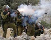 israeli soldiers firing tear gas at palestinian demonstrators.