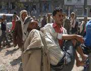an injured yemeni protester is carried away during a demonstration in the southern city of taizz on december 5, 2011.