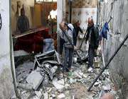palestinian men inspect damage to a house following an israeli airstrike nearby in gaza city on march 10, 2012.
