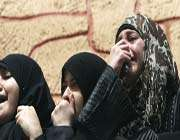 relatives of palestinians killed in israeli airstrikes grieve during in gaza city, march 11, 2012.