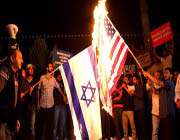 turkish demonstrators burn israeli and us flags during a protest against an anti-islam film in istanbul