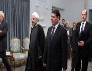 iranian president hassan rohani (l) meets with syrian prime minister wael al-halqi in tehran on august 4, 2013